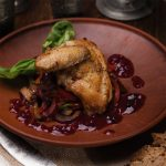 Chicken with goose and cherry in whiskey